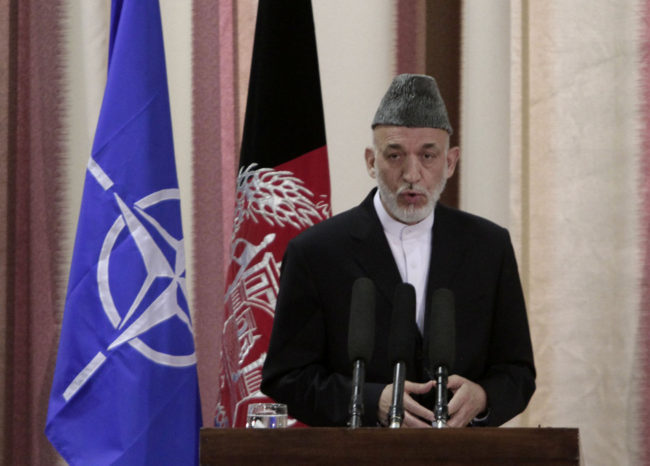 Afghan President Hamid Karzai speaks during a ceremony Tuesday at a military academy on the outskirts of Kabul. Rahmat Gul/AP