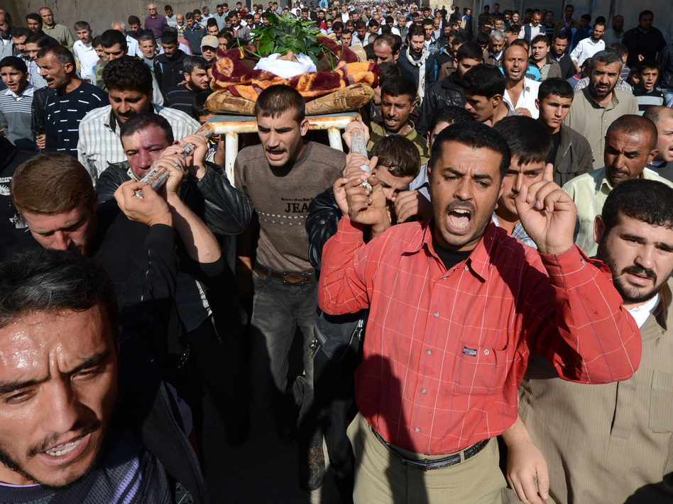 Mourners carry the body of a man killed last fall in the northern Syrian town of Azaz. Philippe Desmazes /AFP/Getty Images