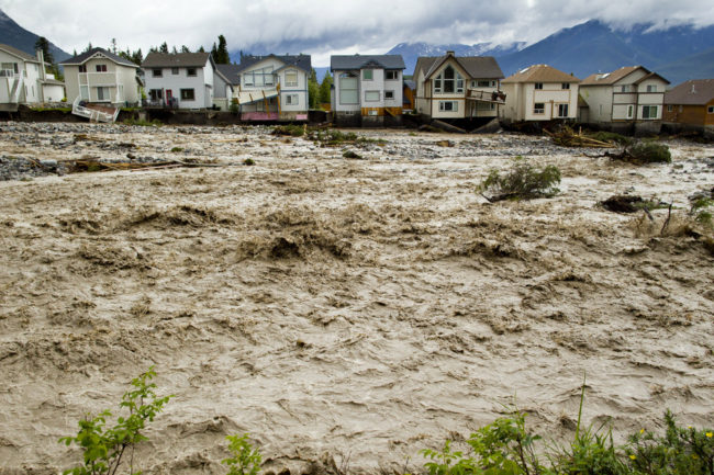 Houses damaged along the edge of Cougar Creek in Canmore, Canada. Widespread flooding caused by torrential rains washed out bridges and roads prompting the evacuation of thousands on Thursday. John Gibson/Getty Images
