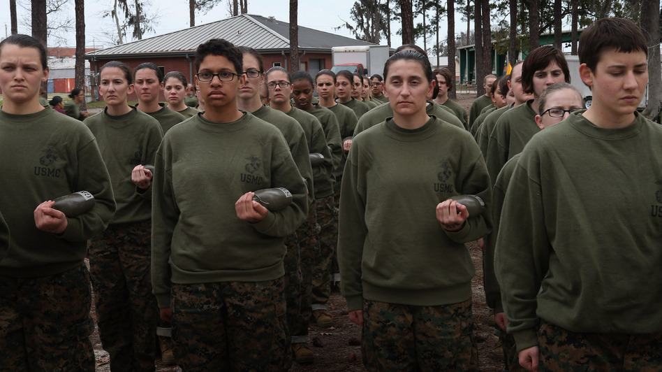 Women in the U.S. military will be integrated into front-line combat units by 2016, the Pentagon says. Here, female Marine recruits stand in formation during pugil stick training in boot camp earlier this year at Parris Island, S.C. Scott Olson/Getty Images
