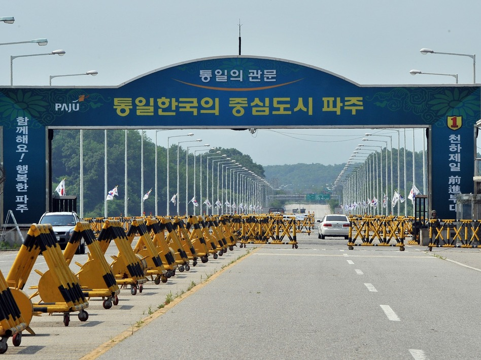 Cars drive past barricades on the road linking North Korea's Kaesong Industrial Complex at a military checkpoint in Paju, near the demilitarized zone dividing the two Koreas, on Thursday. Jung Yeon-je/AFP/Getty Images