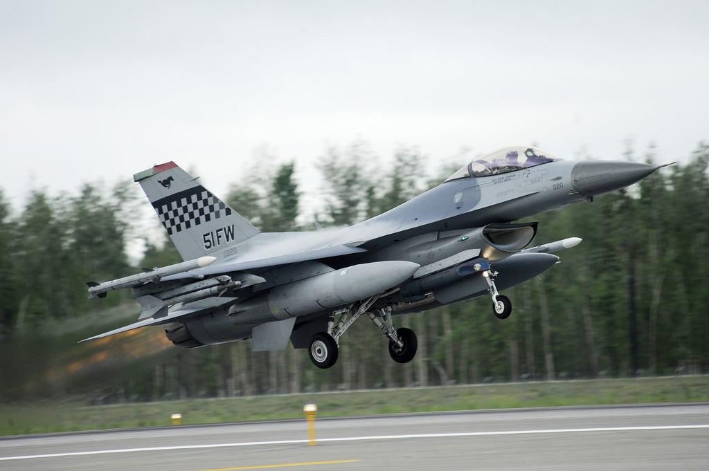 A U.S. Air Force F-16 Fighting Falcon fighter aircraft assigned to the 36th Fighter Squadron (FS) launches June 11, 2012, during Red Flag-Alaska 12-2 at Eielson Air Force Base, Alaska. The F-16 is a compact, highly maneuverable fighter aircraft, vastly proven in air-to-air combat and air-to-surface attack. The 36th FS is out of Osan Air Base, South Korea. (U.S. Air Force photo by Staff Sgt. Jim Araos)