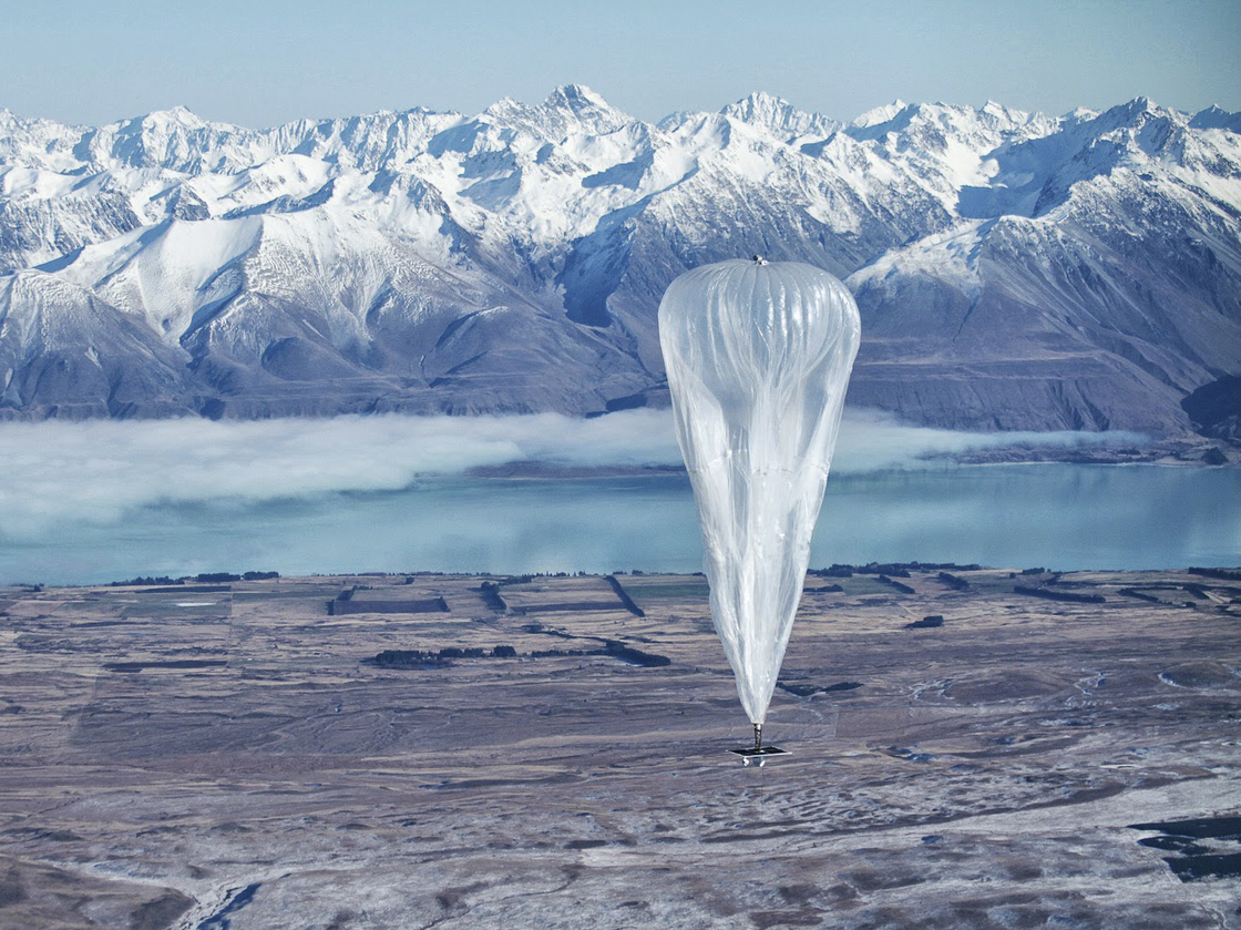 A Google balloon sails through the air with the Southern Alps in the background, in Tekapo, New Zealand, on Monday. Jon Shenk/AP