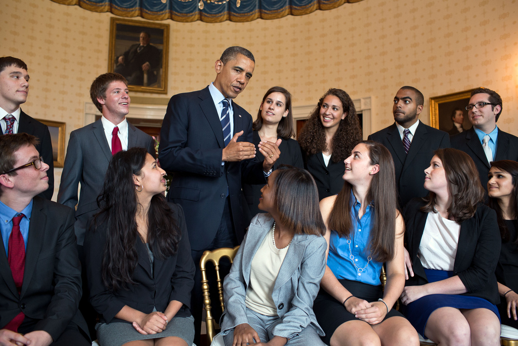 President Barack Obama greets students in the Blue Room of the White House before delivering a statement on college affordability and interest rates on student loans, June 21, 2012. (Official White House Photo by Pete Souza)