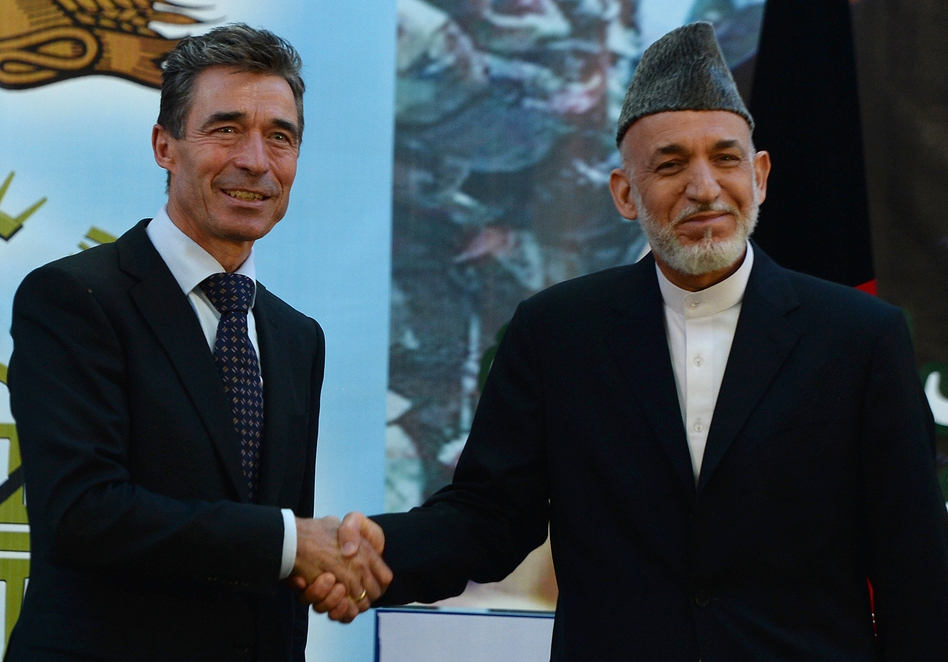 Afghan President Hamid Karzai shakes hands with NATO Secretary-General Anders Fogh Rasmussen after a security handover ceremony at a military academy outside Kabul on Tuesday. Shah Marai/AFP/Getty Images