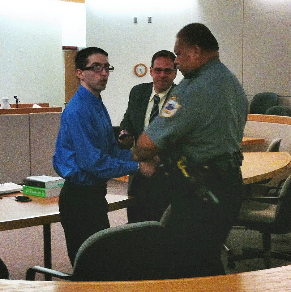 David J. Paul talks to his grandmother in the courtroom gallery following the verdict in his case while Judicial Services Officer Al Fenumiai handcuffs him and public defender Eric Hedland watches. Photo by Matt Miller/KTOO News