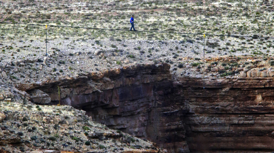 Daredevil Nik Wallenda crosses a tightrope 1,500 feet above the Little Colorado River Gorge, Ariz., on Sunday. Rick Bowmer/AP