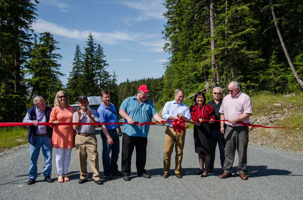 Senator Dennis Egan, Representative Cathy Munoz, General Manager of Kensington Gold Mine Wayne Zigarlick, Mayor Merrill Sanford, Gov. Sean Parnell, Chair of the Goldbelt Board of Directors Cheryl Eldemar, Local 71 Representative Tom Brice, and DOT Commissioner Pat Kemp cut the ribbon.