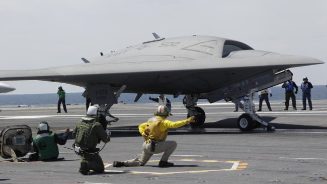 A Navy X-47B drone, seen here last month being launched off the aircraft carrier USS George H. W. Bush, successfully landed on the ship Wednesday, a first. Steve Helber/AP