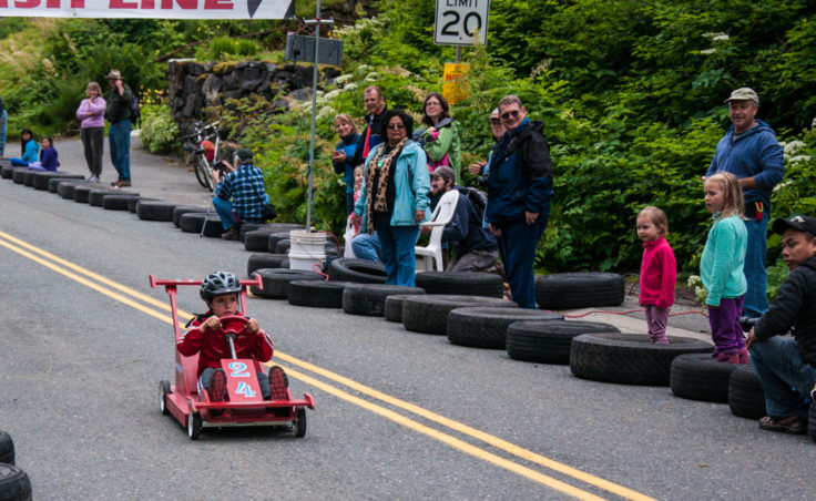A soapbox derby races flies across the finish line.