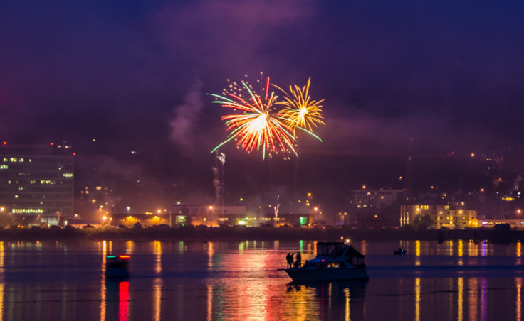 Boats anchored in Juneau's harbor watch the fireworks.