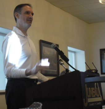 Assistant Attorney General Ed Sniffen addresses the Juneau Chamber of Commerce on July 11.