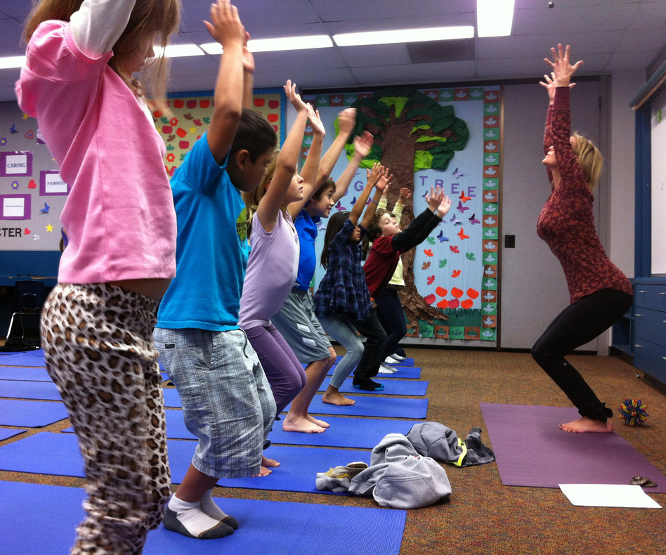 Third-graders at Olivenhain Pioneer Elementary School in Encinitas, Calif., perform chair pose with instructor Kristen McCloskey in December 2012. Kyla Calvert for NPR