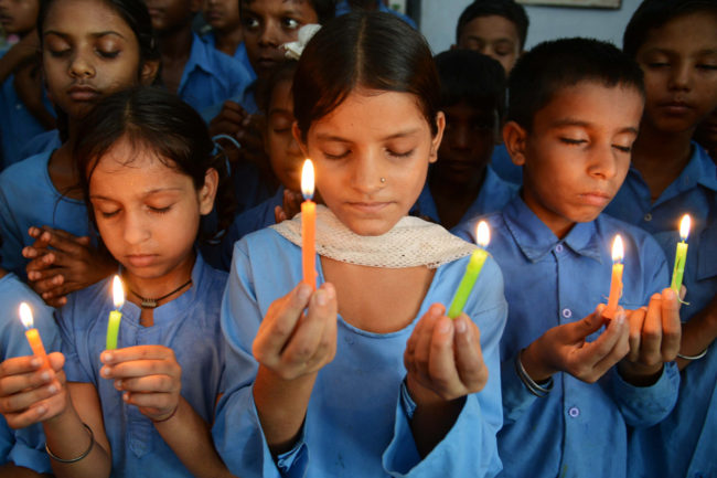 Indian school children hold candles as they pay tribute to school children who died from food poisoning in Saran district of Bihar state. Narinder Nanu /AFP/Getty Images