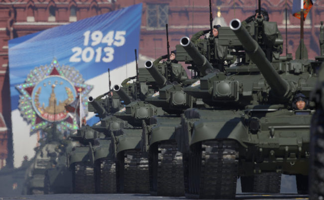 Russian tanks move along Red Square during a Victory Day parade in May. This week, Russia invited the U.S. to participate in a tank biathlon. Ivan Sekretarev/AP