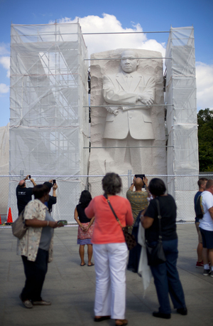 Under Construction: A recent survey of Americans found that fewer than half believe the U.S. has made substantial progress toward racial equality. Here, the Martin Luther King Jr. Memorial in Washington, D.C., is boxed in by scaffolding as work is done on it. Pablo Martinez Monsivais/AP