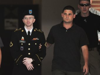 Army Pfc. Bradley Manning is escorted from court on July 25, in Fort Meade, Md. Mandel Ngan/AFP/Getty Images