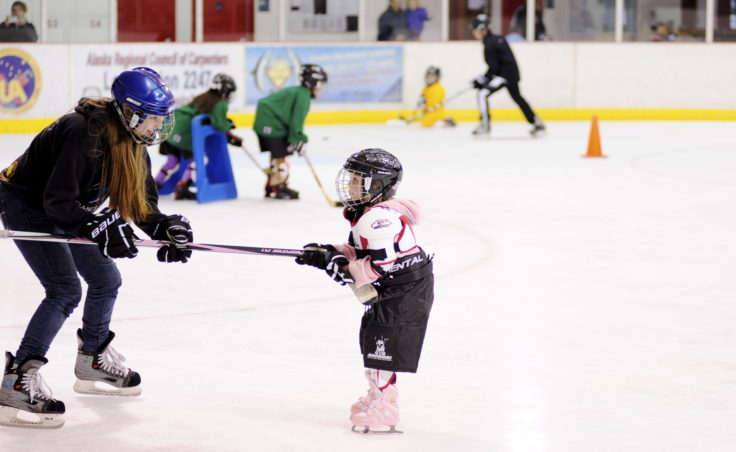 Myrica Wildes pulls Sydney Hood along the ice during JDIA's Learn to Play event Saturday at Treadwell Ice Arena.