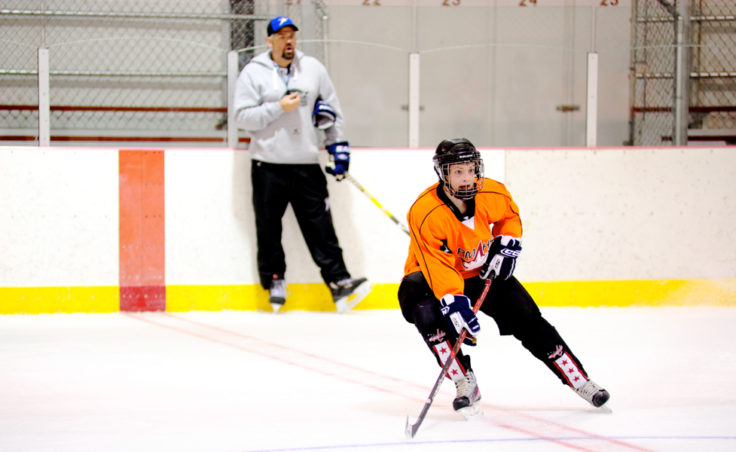 Ryan Moritz closes out one of practice sessions at the Rocky Mountain Hockey School with a skating drill calling for quick stops.