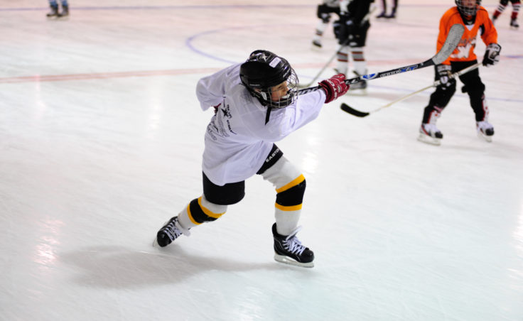 Gage Cooney unleashes a shot during one of the drills of the Rocky Mountain Hockey School at Treadwell Ice Arena