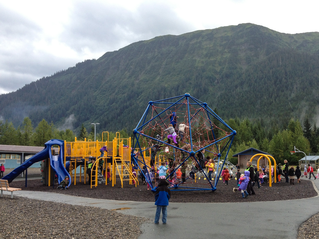 Kids play on the climbing web at Glacier Valley Elementary School.
