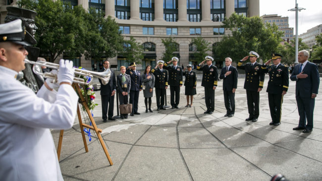 One day after 12 people and an alleged gunman died at the Navy Yard in Washington, D.C., details about their lives are beginning to emerge. On Tuesday, Defense Secretary Chuck Hagel (far right) attends a wreath-laying ceremony at the U.S. Navy Memorial in honor of the victims. Drew Angerer/Getty Images