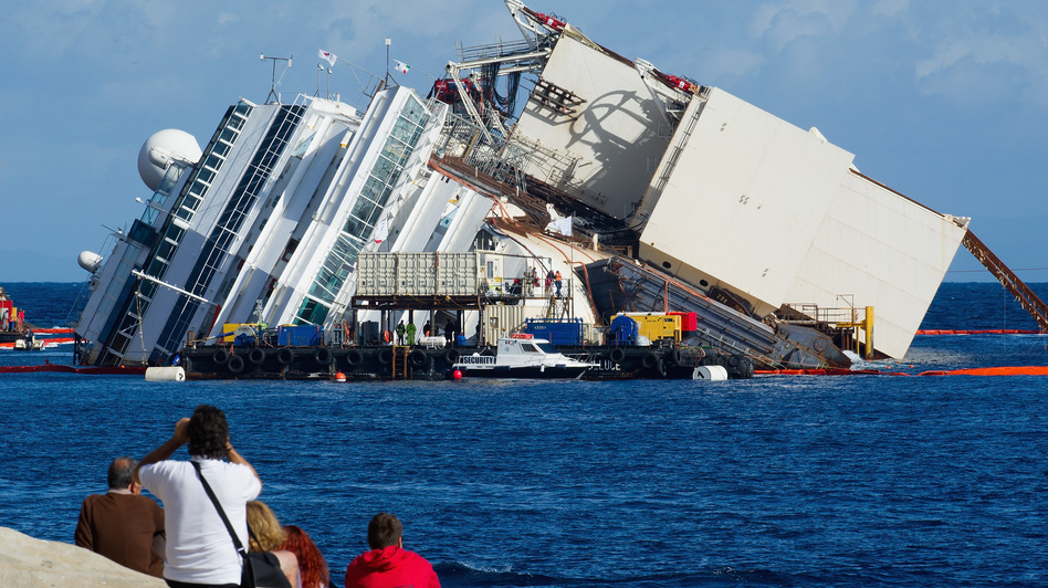 The view Monday from shore as work began to pull the Costa Concordia upright. The box-like structure on the ship's port side is one of the refloating caissons that will stabilize the ship. Marco Secchi/Getty Images