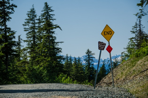 Signs mark the current end of Juneau's  Glacier Highway. A state transportation plan calls for extending the road north 47 miles to a new ferry terminal. Photo by Heather Bryant / KTOO.