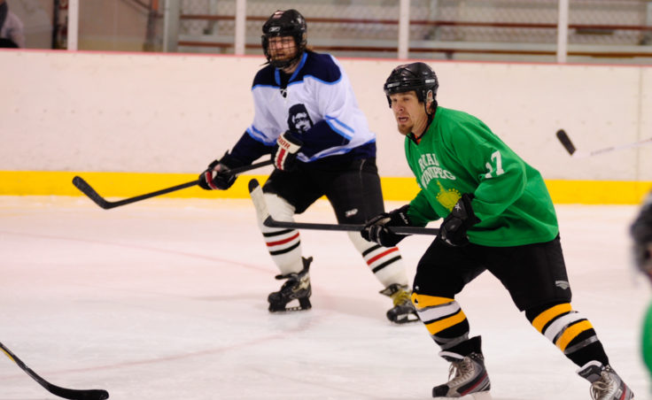 Mason Morriss (right) and Thomas McKenzie have their sights set on the play in a Tier B game between Alaska Airlines and the Green team during JAHA's round of opening day games.
