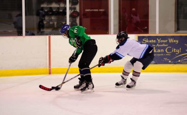 Dana Hanselman chases down Bill Holbrook in a Tier B game between Alaska Airlines and the Green team during JAHA's round of opening day games.