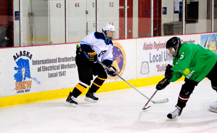 Angel Kwok of Alaska Airlines evades a Green team defender's reach in a Tier B game that helped JAHA kick off the fall season.