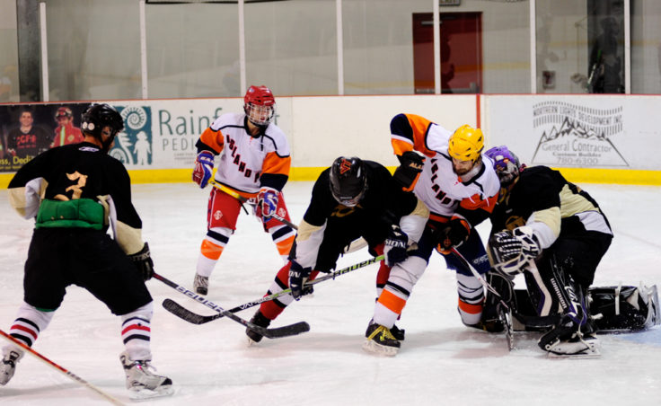 Traffic in front of the net was a common occurrence in Sunday's Tier A game between Island Pub and the Viking. Island Pub kicked off opening day for JAHA with a 5-2 victory.