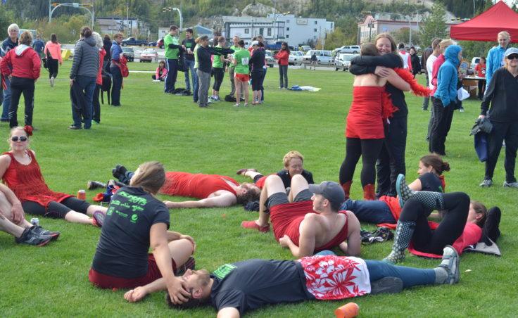 Klondike Red Dress Runners enjoy the finish