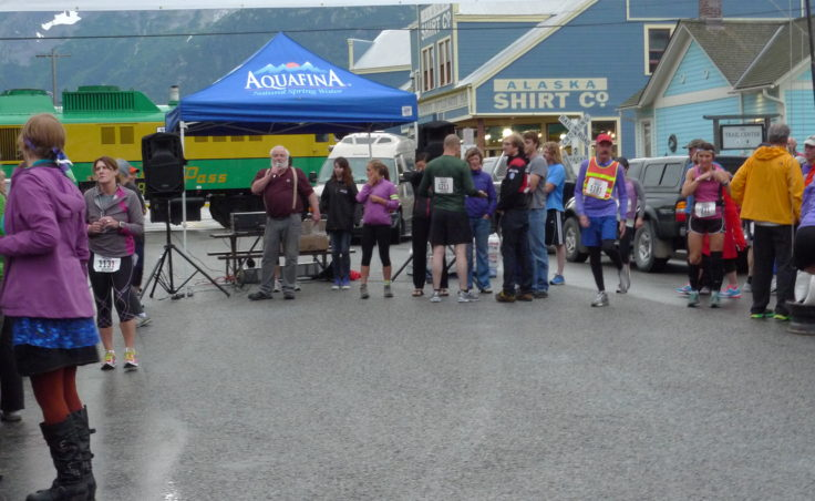 Buckwheat Donahue lines up runners at the Klondike starting line