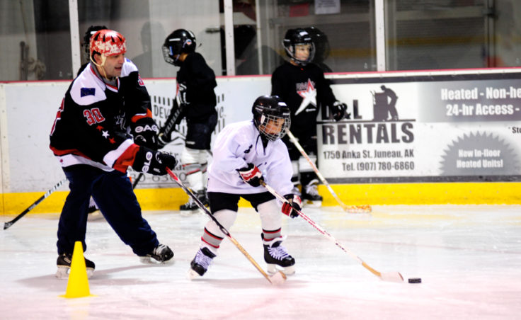 Steve MacSwain works closely with players like Ian Moller from the Juneau Douglas Ice Association during his two-day, weekend youth hockey camp.