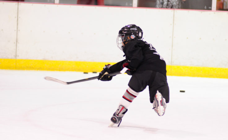 Tezah Haddock unleashes a shot during a drill that required the player to collect a pass, skate toward the net and shoot.