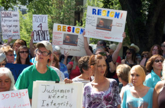 Protesters gathered outside the Yellowstone County Courthouse in Billings, Mont., on Thursday, call for the resignation of a state judge over comments he made about the teenage victim in a rape case. Matt Brown/AP