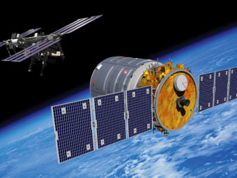An artist's rendering of the Cygnus spacecraft approaching the International Space Station. Orbital Sciences