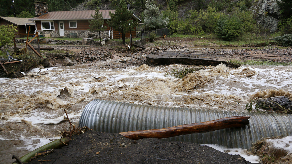 This home was stranded Thursday after a flash flood in Coal Creek destroyed a bridge near Golden, Colo. Rick Wilking /Reuters /Landov