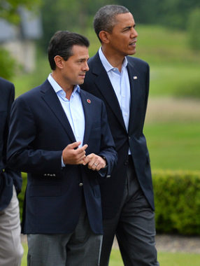 New reports allege that the NSA spied on Mexican President Enrique Pena Nieto, seen here walking with President Barack Obama in June, when he was a candidate for office. Mexico and Brazil have demanded a response to charges of U.S. spying on their internal affairs. Ben Stansall/AFP/Getty Images