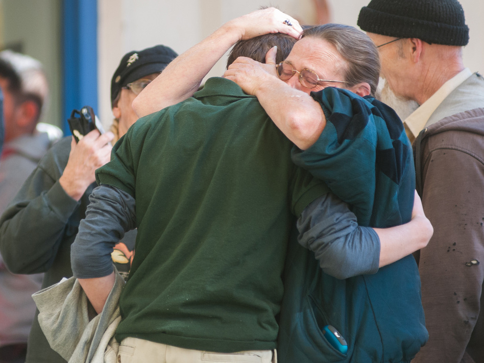 A Sparks Middle School student cries with family members after the shooting in Sparks, Nev. on Monday. Kevin Clifford/AP