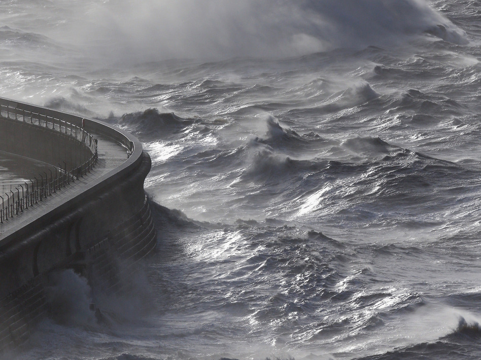 Waves produced by storm-force winds break against the harbor wall in Dover, England, on Monday. Oli Scarff/Getty Images