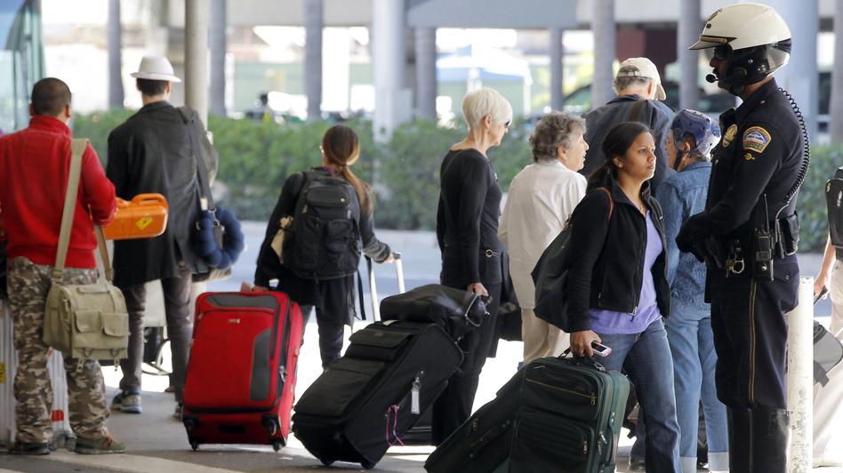 Police at Los Angeles International Airport stepped up patrols this week after two dry ice explosions. There have since been two arrests.    Nick Ut/AP
