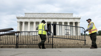 Members of the U.S. Park Service place barricades around the Lincoln Memorial on Tuesday in Washington, D.C. A partial shutdown of the federal government has led to the closing of national parks. Brendan Smialowski/AFP/Getty Images