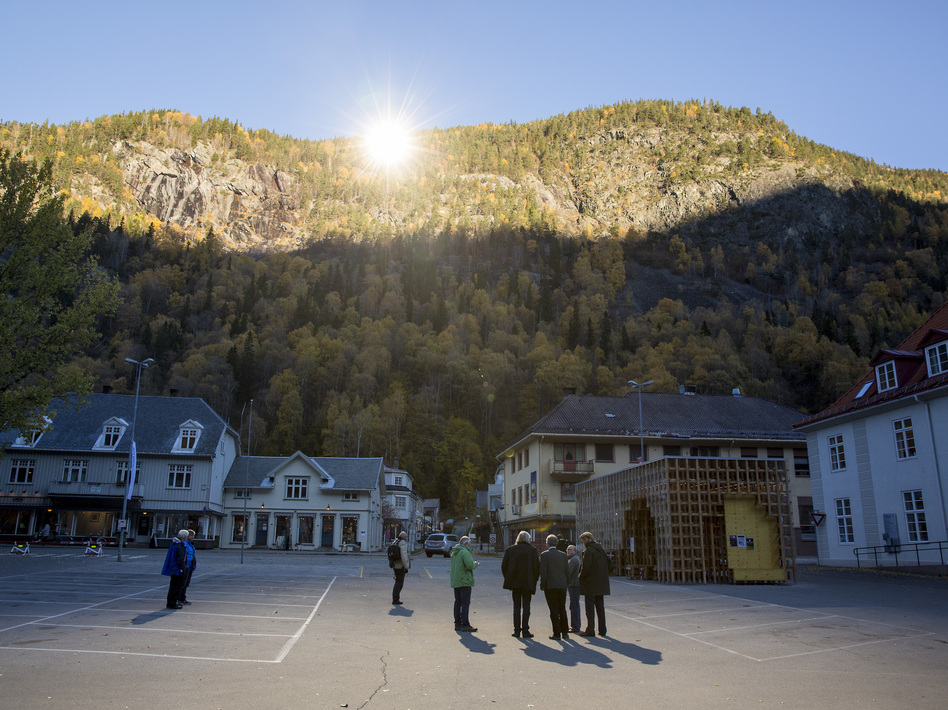 People gathered on a spot in front of the town hall of Rjukan, Norway, last week, where mirrors have focused sunlight. AFP/Getty Images