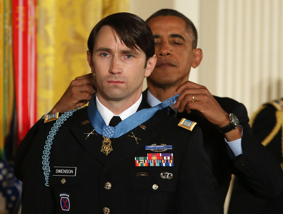 President Obama gives former U.S. Army Capt. William Swenson the Medal of Honor during a ceremony at the White House on Tuesday.     Mark Wilson/Getty Images