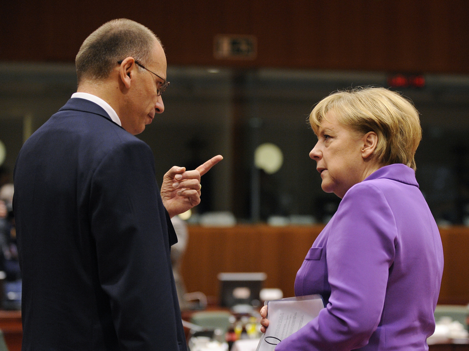 German Chancellor Angela Merkel (right) talks with Italian Prime Minister Enrico Letta on the second day of an European Council meeting in Brussels on Friday. John Thys/AFP/Getty Images