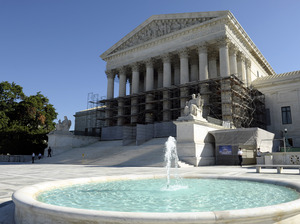 The Supreme Court is expected to take up the case on the greenhouse gas permits for large polluters early next year. Susan Walsh/AP