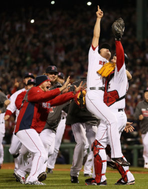 Boston Red Sox relief pitcher Koji Uehara points to the sky as he and his teammates celebrate their World Series victory Wednesday. Rob Carr/Getty Images
