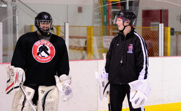 Goaltender coach Heather Strickland chats with player/coach Neal Chapman, who is a varsity goalie for Juneau Douglas High School.